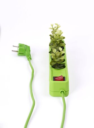 Electric socket with green plants on white background Banque d'images - 127833500