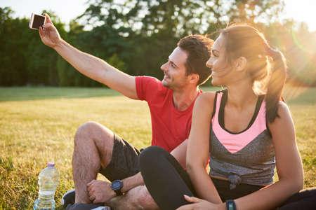 Motivated ciuple taking running selfie Stock Photo