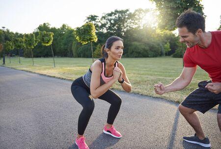 Man motivates woman during hard workout Stock Photo