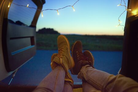 Close up of couple's legs in a car 스톡 콘텐츠