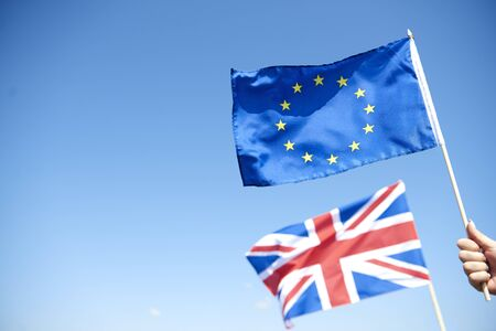 European Union Flag and blurred British flag in the background