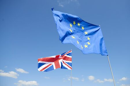 Flags of  European Union and Britain in front of sky
