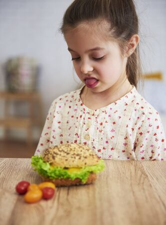 Disgusted child looking at healthy sandwich