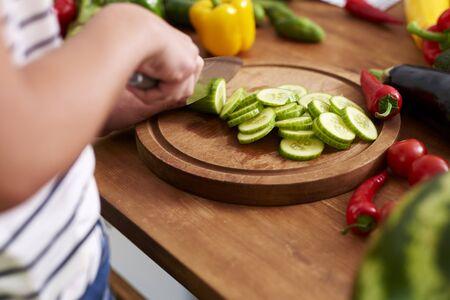 Wooden board and freshness cucumber slices Reklamní fotografie