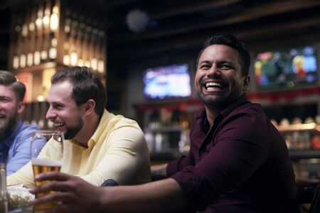 Men watching american football in the pub