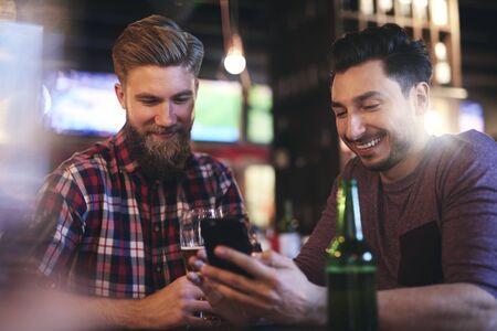 Two men spending time together in the pub Reklamní fotografie - 129682863
