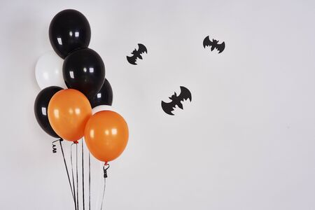 Halloween banner with bats and balloons