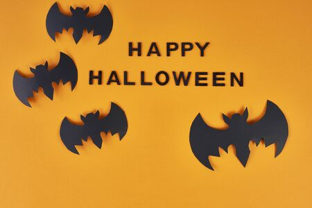 """Background with text """"happy Halloween"""" and bats"""