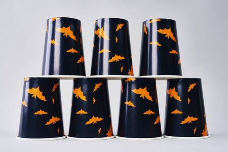 Stack of disposable mugs for Halloween party