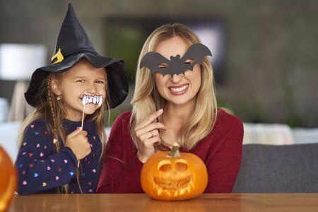 Portrait of mother and daughter with halloween masks Reklamní fotografie - 130848974