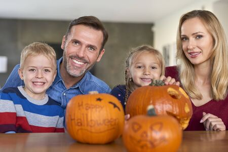 Portrait of smiling family in Halloween time