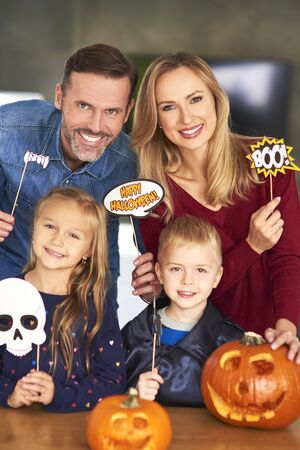 Playful family in halloween masks