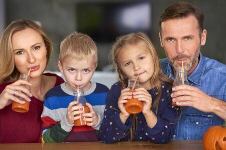 Portrait of happy family drinking smoothie Reklamní fotografie