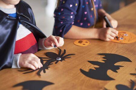 Children preparing decorations for Halloween