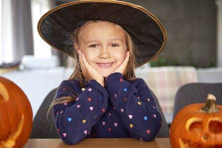 Portrait of smiling girl in witch costume Standard-Bild