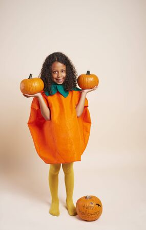 Happy African girl with halloween pumpkins  版權商用圖片