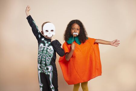 Cheerful children with Halloween costume