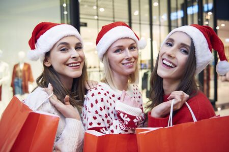 Three beautiful women with gifts during the Christmas shopping