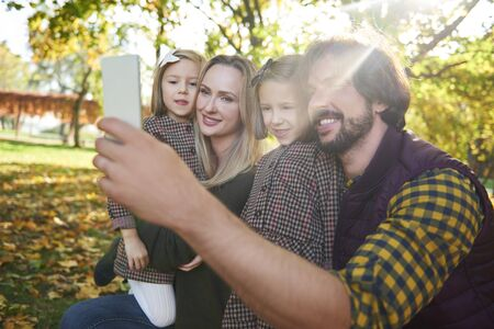 Happy family making a selfie in autumn forest Stok Fotoğraf