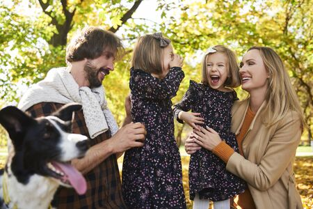 Joyful scene of family in autumn forest Stock fotó