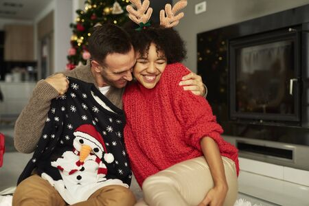 Affectionate couple embracing at Christmas