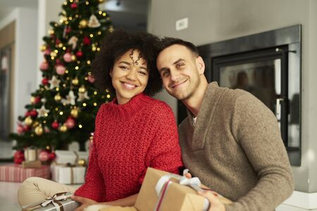 Portrait of affectionate couple ready for Christmas