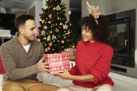Man giving the big Christmas gift