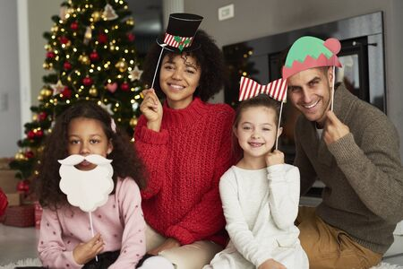 Portrait of happy family in Christmas masks