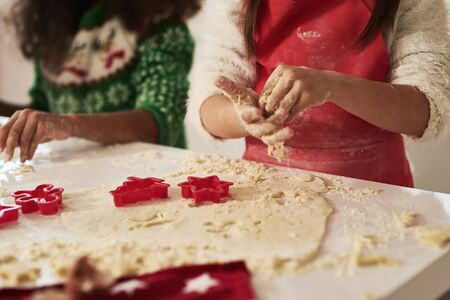Close up of children making cookies for Christmas Stok Fotoğraf