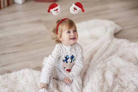 Charming baby in Christmas morning