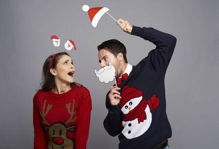 Playful couple celebrating Christmas time