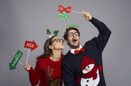 Romantic moment for nerd couple at Christmas Stock Photo