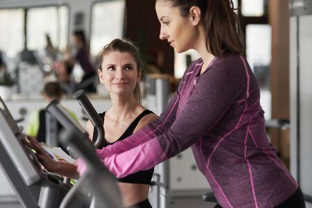 Coach training female athlete Stock Photo