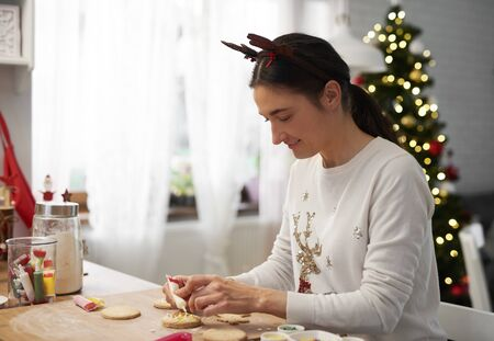 Happy woman baking cookies for Christmas