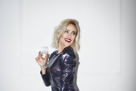 Glamorous woman with champagne looking at copy space Archivio Fotografico
