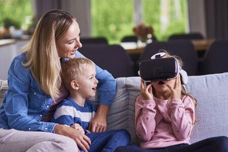 Child using virtual reality simulator