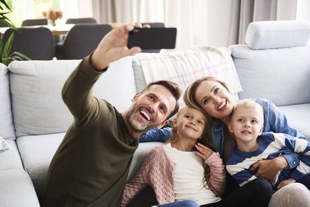 Selfie of happy family with two children