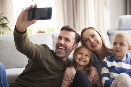 Cheerful family took a selfie Stock Photo - 137331888