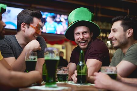 Group of men enjoying time together in the pub