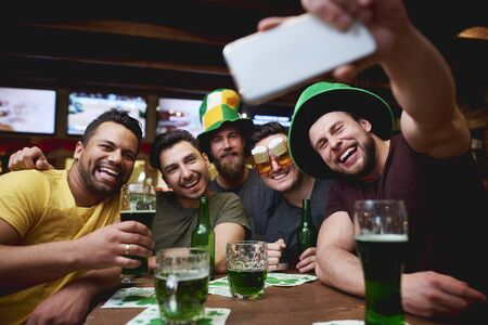 Great selfie of group of friends in the pub