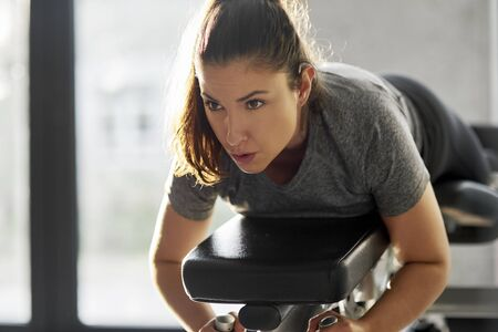 Determined woman exercising at gym