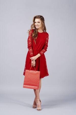 Portrait of beautiful woman holding shopping bag