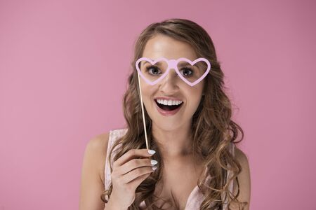 Screaming woman with heart shaped glasses