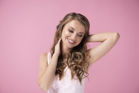 Charming woman smiling in the studio shot 写真素材