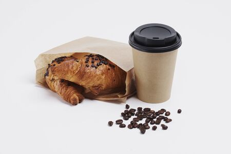 Disposable mug of hot coffee and croissant 版權商用圖片