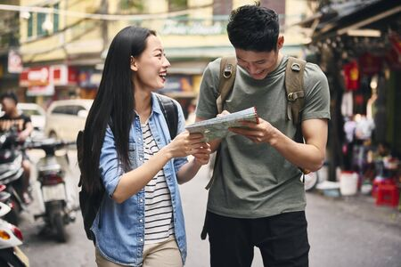 Tourists with map in the city