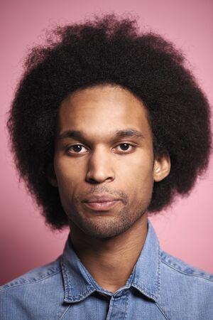 Portrait of young African man in studio shot.