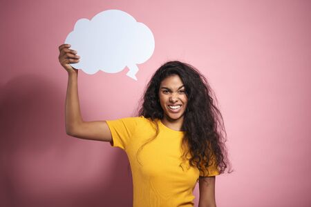 Young African woman with empty speech bubble in studio shot.