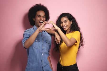 Happiness young African couple making a heart with hands. Stock Photo - 149736299