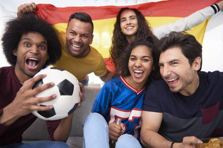 Emotional football fans during watching match